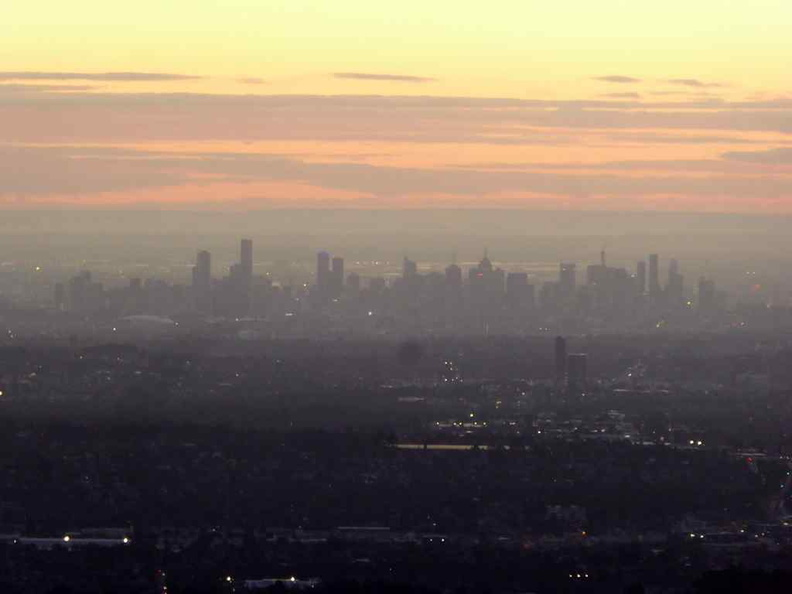 A distant Melbourne city seen from afar on the mountain