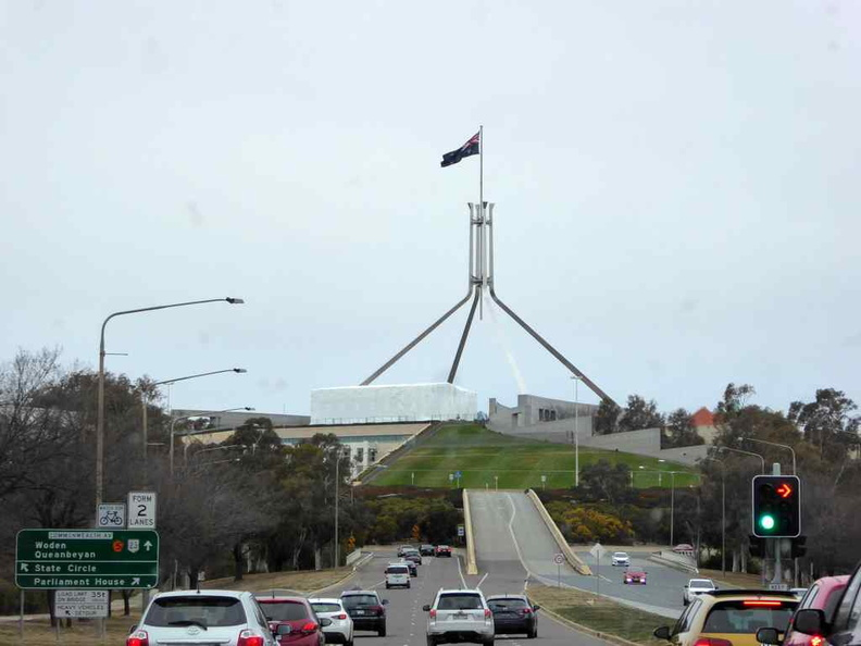 The Australian Parliament as seen from afar driving in towards Capital Hill