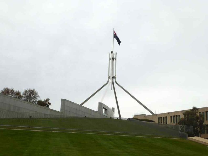 The highly distinguishable giant four legged flagpole sitting above the new Parliament House