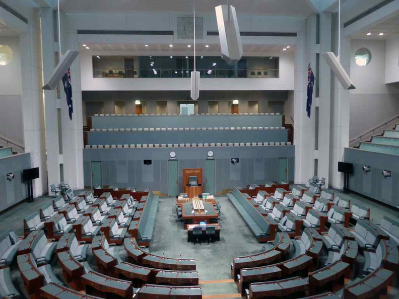 Overview of the House of Representatives. It has a very similar layout the Senate chamber, but in a muted hue of greenish-grey