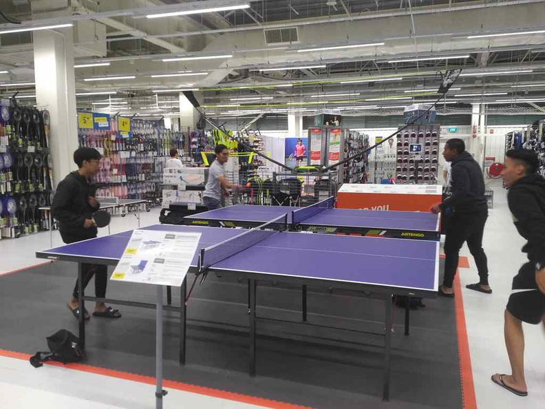 Patrons using the open Table Tennis tables. It is quite a popular station in the store