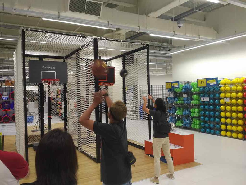 Shooting the hoops at the basketball and soccer ball section