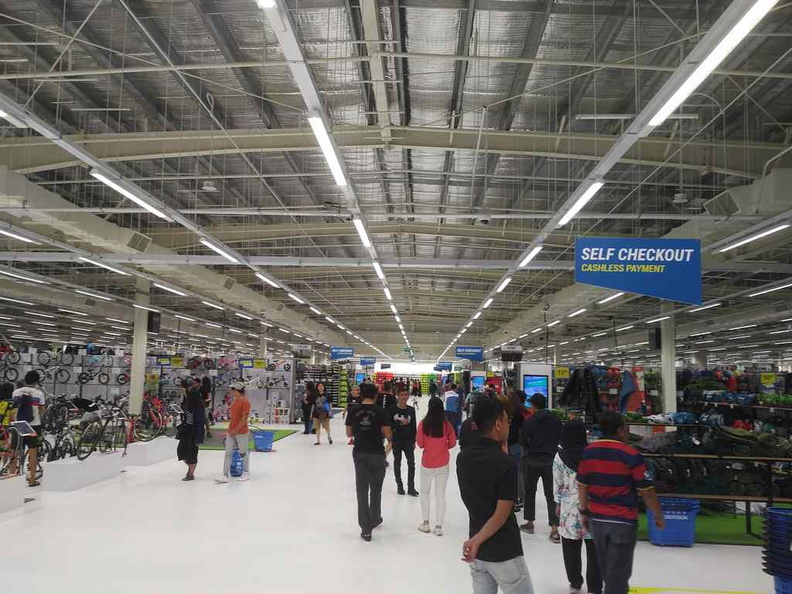 A vast central open hallway greets you as you enter the store. Sports equipment are tucked on the sides with each aisle dedicated to a sport each.