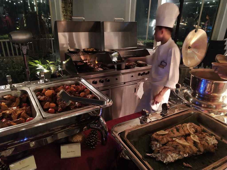 The open grill where you can see your food cooked by the hotel chefs behind the food counters.