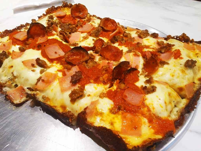 The rectangular meat lovers deep dish pizza. It is not as deep as expected, but makes up for it with taste and an addictively Crispy outer crust