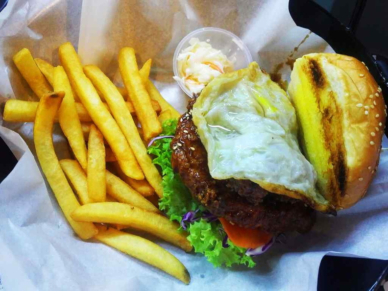The signature coffee pork rib burgher with optional egg added.
