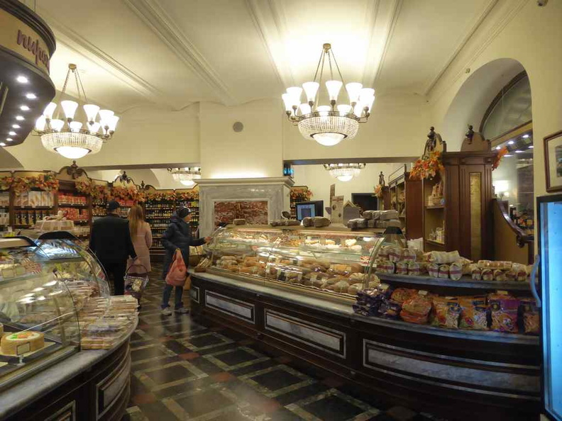 General supermarket ambience. It has an oldie look to it, complete with dark wood shelves, tiled flooring lit with topped chandeliers