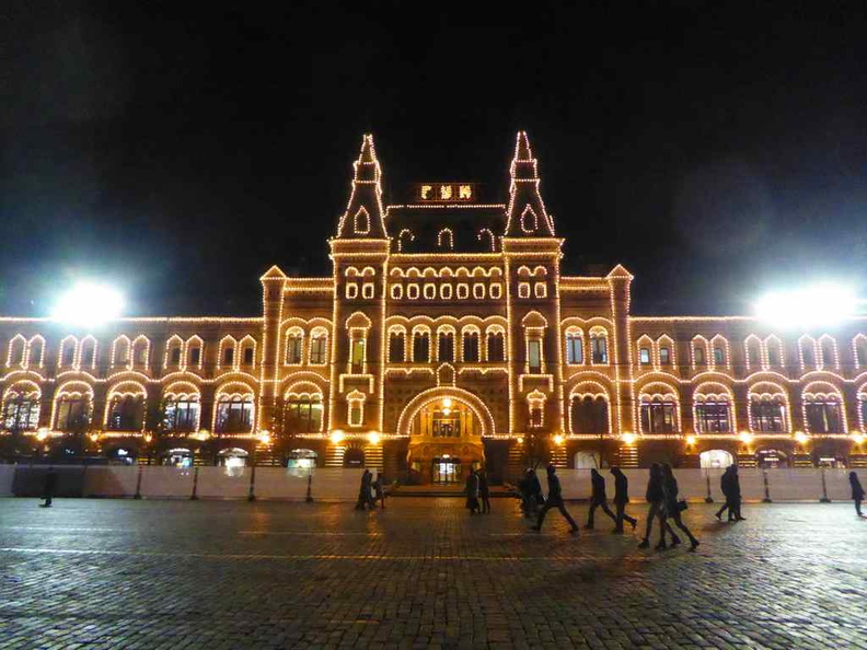 The front of the mall, lit at night from the red square