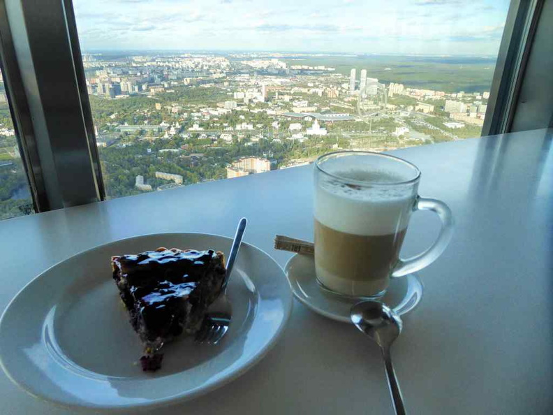 Enjoying the views on the revolving cafe with freshly-made coffee and cheesecake