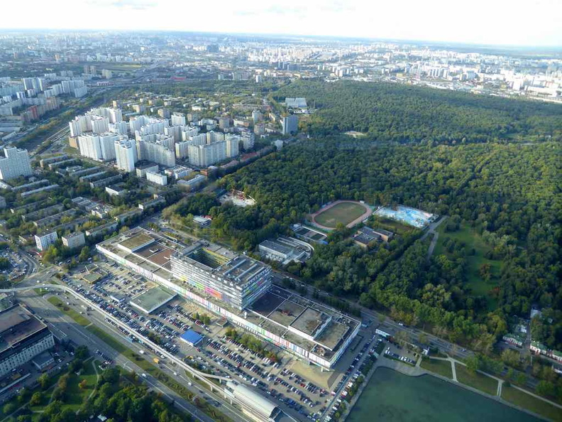 The TV station, monorail station and adjacent reservoir. Notably, it is surrounded by alot of green among the neighborhood buildings