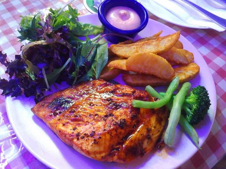 Their Grilled Salmon, the fish is juicy and soft. It is cooked lightly seared on the exterior but retains an otherwise soft juicy inner core