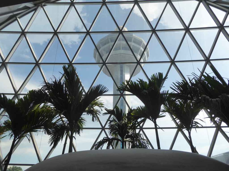 View of the Changi Airport central control tower looking through the Jewel glass panels