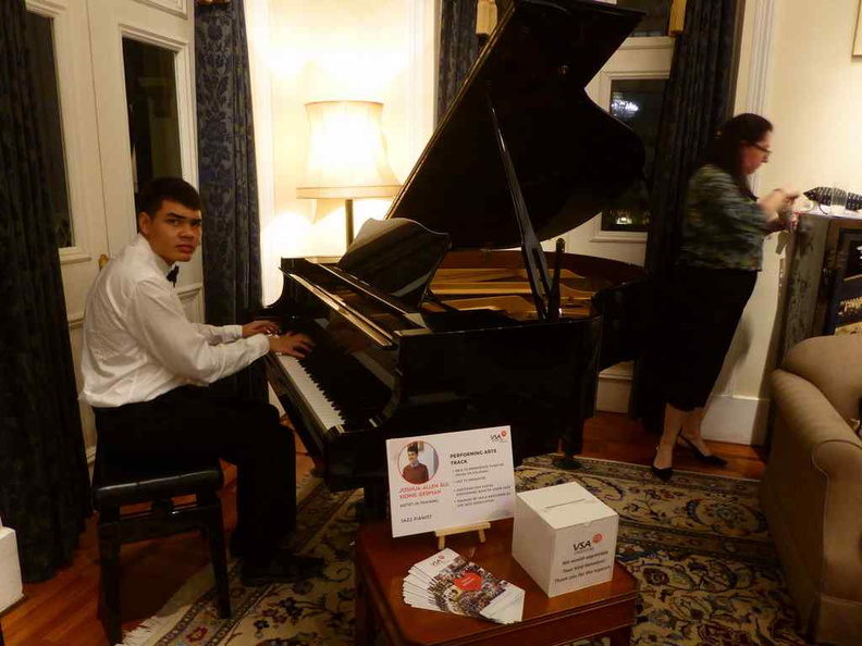 Joshua German performing on the piano at the event lounge. , filling the halls with his music