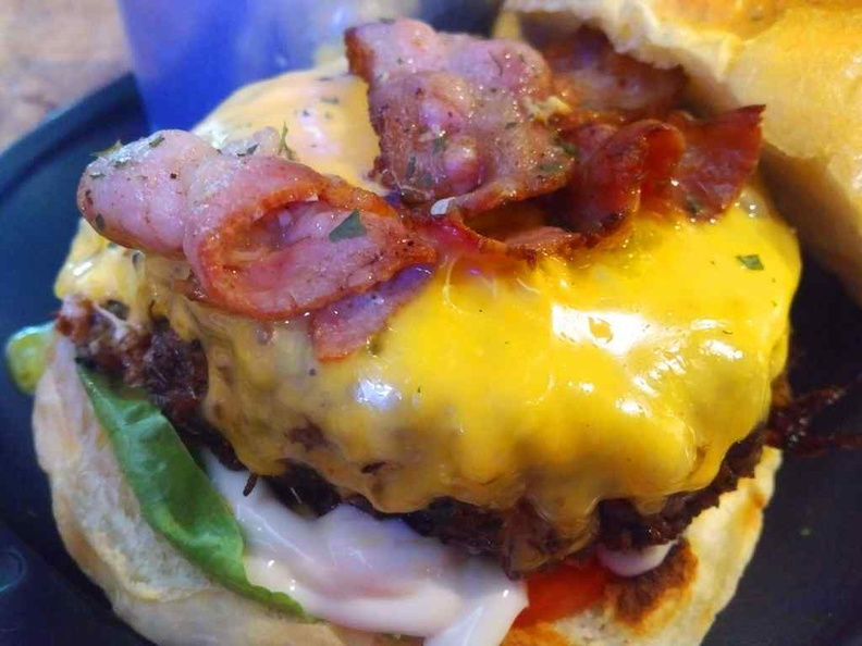 Close-up of the Wagyu burger with the delicious ozzing egg and bacon