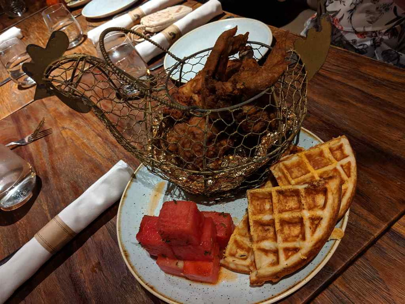 Yardbird Signature fired chicken and Watermelon and Waffles ($40). It is essentially a southern-style fried chicken platter