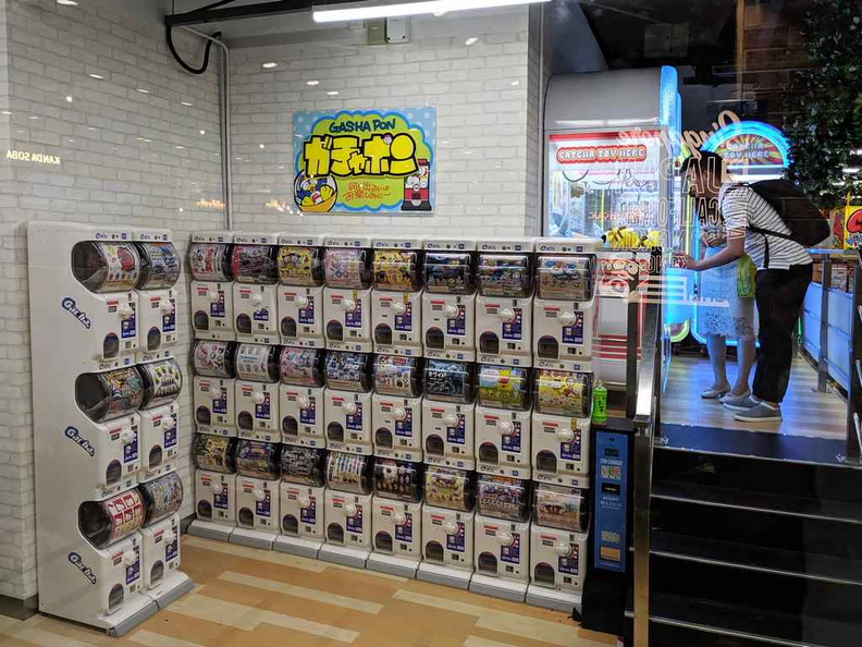 The Gashapon wall at the exit of the outlet. There is also a row of UFO catcher machines alongside it