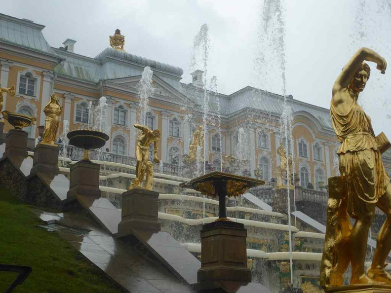 The grand cascade and the lines of golden sculptures placed along the slope
