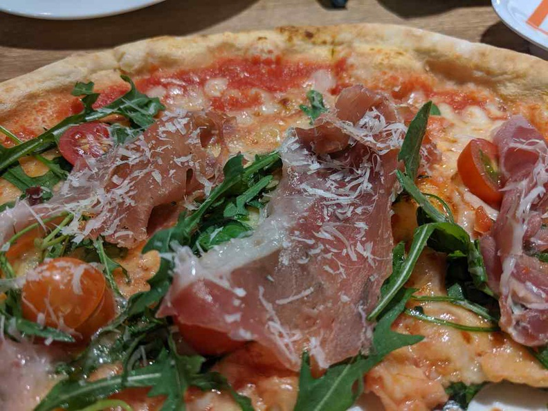 Prosciutoo and Rocket piuzza, dry cured ham rocket and grana padano