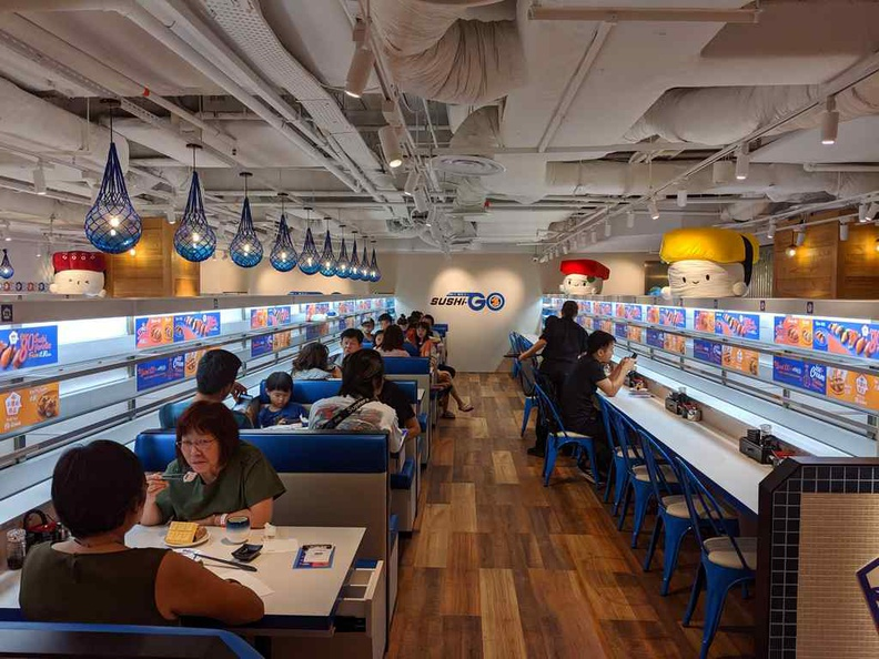 Inside the Sushi-go restaurant. It has separate seating arrangement from the main &JOY food court