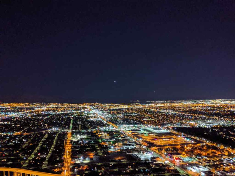Sparkles of distant planes landing and taking off from Las Vegas international Airport from the STRAT observation tower