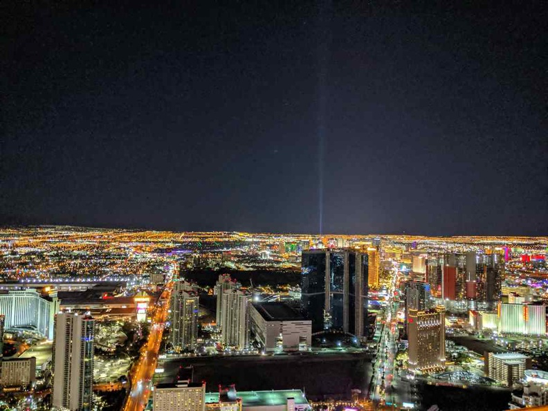 The Las Vegas strip in-view with the Luxor hotel light beam in the distance