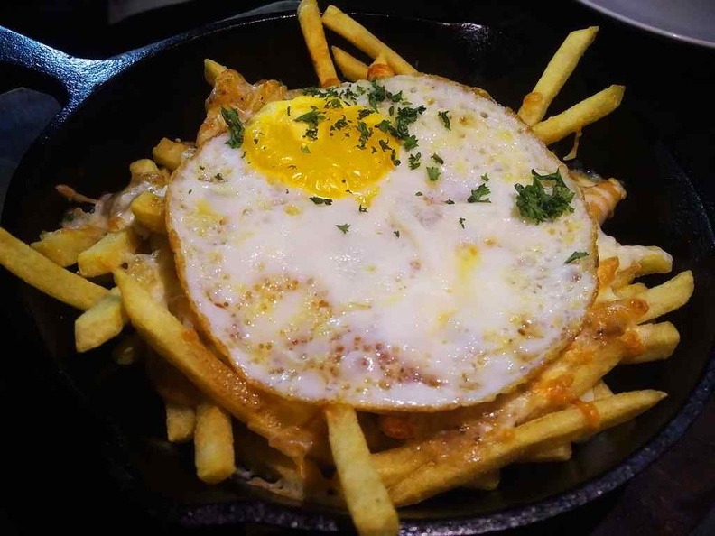 Beast southern kitchen poutine fries ($14) are doused with sausage gravy, mozzarella cheese and a sunny side up egg.