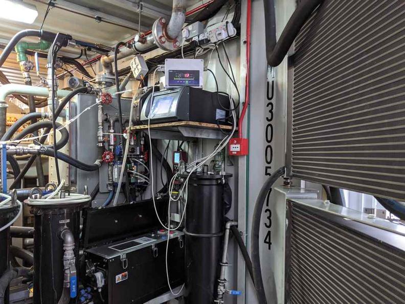 Heat exchangers to heat up water and exhaust excess heat