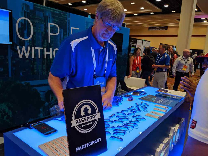 A participating company of the Blackhat Passport treasure hunt, identified by these signs on their booths