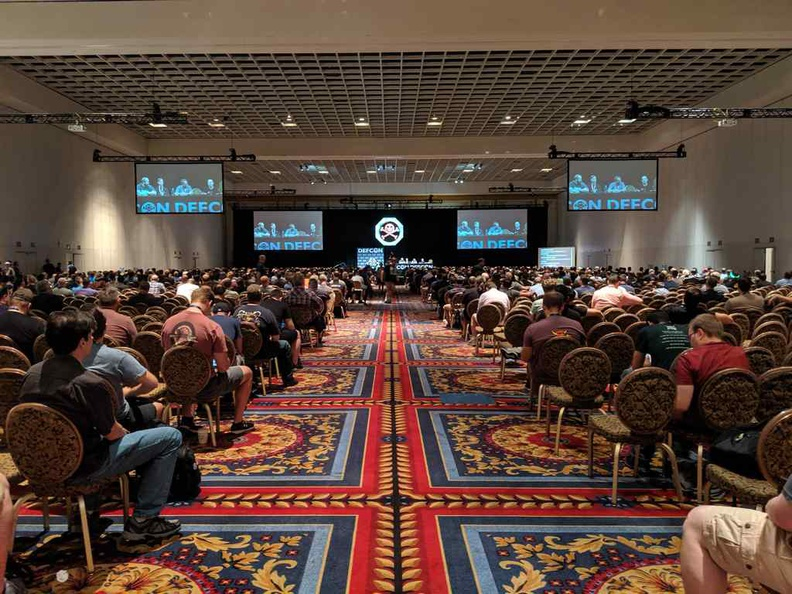 Typical talks in DEFCON hacker convention, both packed with content and attendees