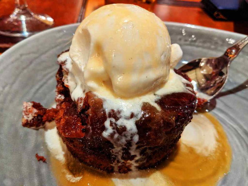 Sticky toffee pudding, a sweet contraption of vanilla on a warm heated chewy pudding base. It is a recommended dessert at the end of your meal