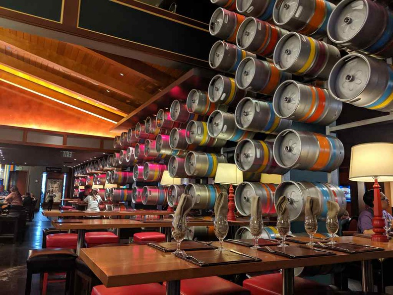 The restaurant interior is cool, modern, and peculiar, such as the wall of beer kegs by the dining areas
