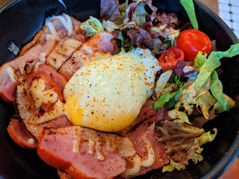 Smoked duck rice bowl with poached egg and sesame sauce ($15.90)
