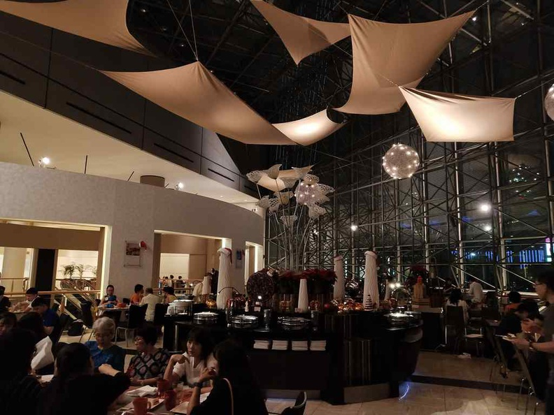The interior with floor to ceiling glass windows. At night the restaurant does feel rather dark, and dimly lit